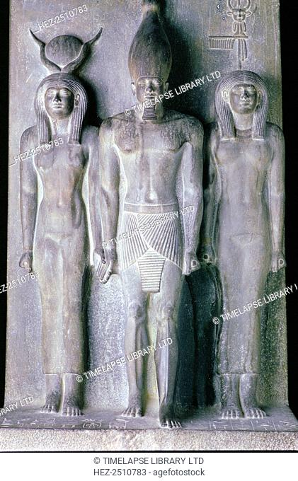 Basalt statue of the Pharaoh Menkaure, Cairo Museum, Egypt. Menkaure (Mycerinus) was a Pharaoh of the 4th dynasty of Ancient Egypt