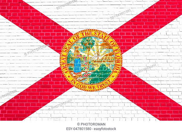 Floridian official flag, symbol. American patriotic element. USA banner. United States of America background. Flag of the US state of Florida on brick wall...