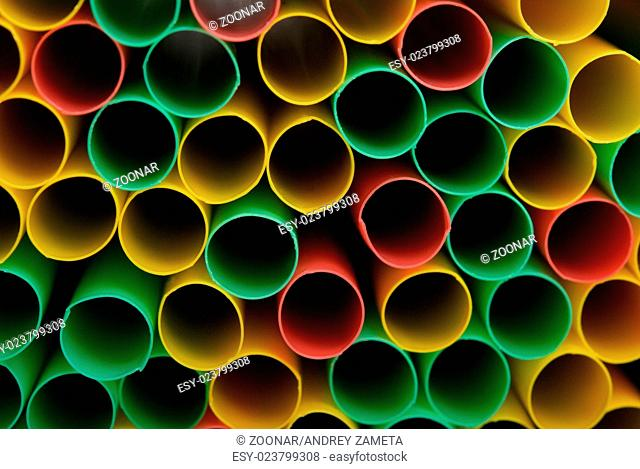 Many multi-coloured straws for drinks