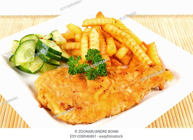 escalope with fries and cucumber