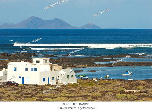 Rock pools and Graciosa Island beyond, near Orzola at the north east tip of the island, Lanzarote, Canary Islands Spain, Atlantic, Europe