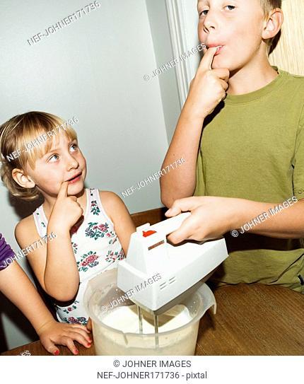 Children whipping cream