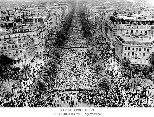 Thousands of demonstrators fill the Champs Elysees, answering President Charles de Gaulle's call for support. After weeks of student riots and a general strike...