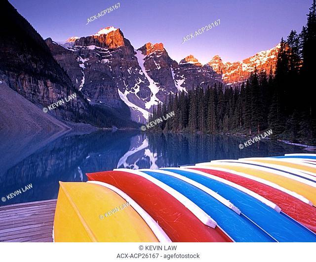 Canoes on dock at Moraine Lake, Banff National Park, Alberta, Canada