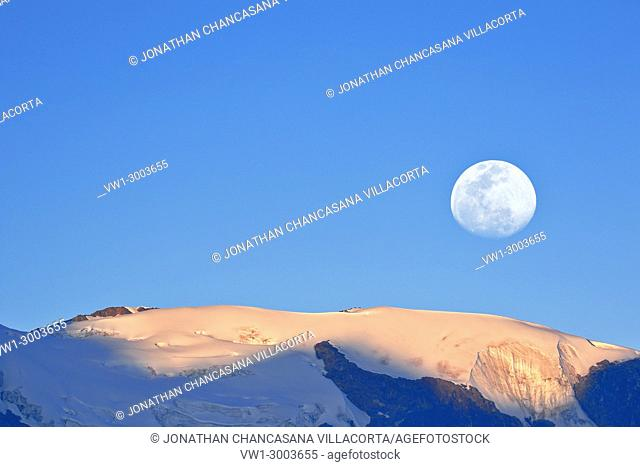 Moon on a summit of the snowy Huaytapallana, achieved using a double exposure from the camera. Huancayo, Perú