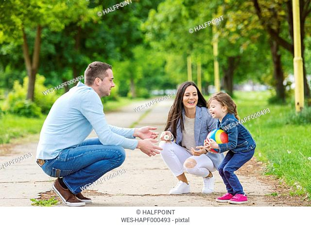Happy family playing in park