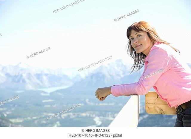 Woman looking out on mountain view