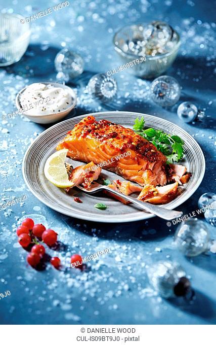 Roasted salmon fillet on plate, seasonal Christmas food