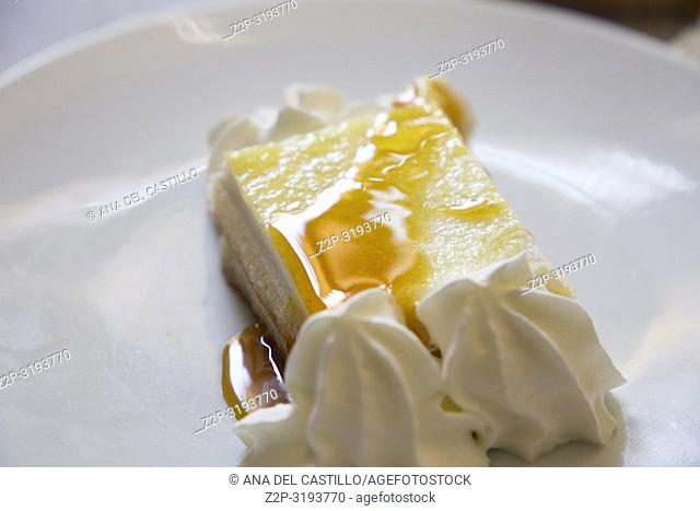 Flan portion with caramel and cream