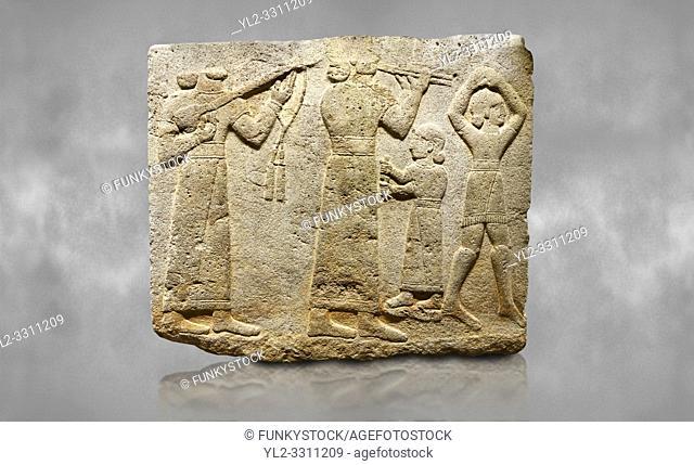 Hittite monumental relief sculpted orthostat stone panel of Procession. Limestone, Karkamıs, (Kargamıs), Carchemish (Karkemish), 900-700 B. C