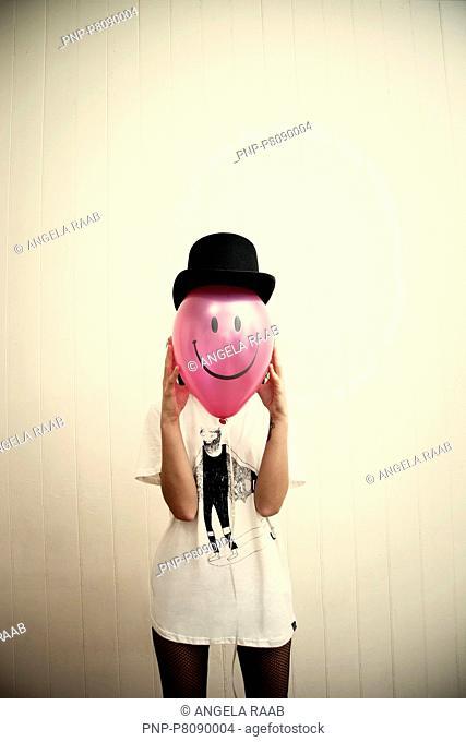 Woman with pink ballon