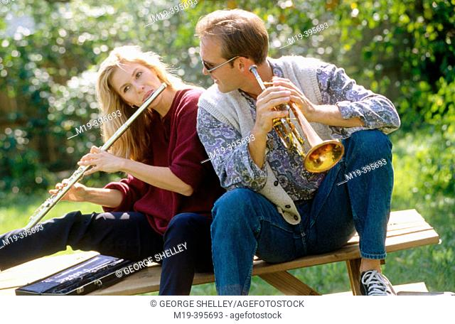 couple having fun, playing music