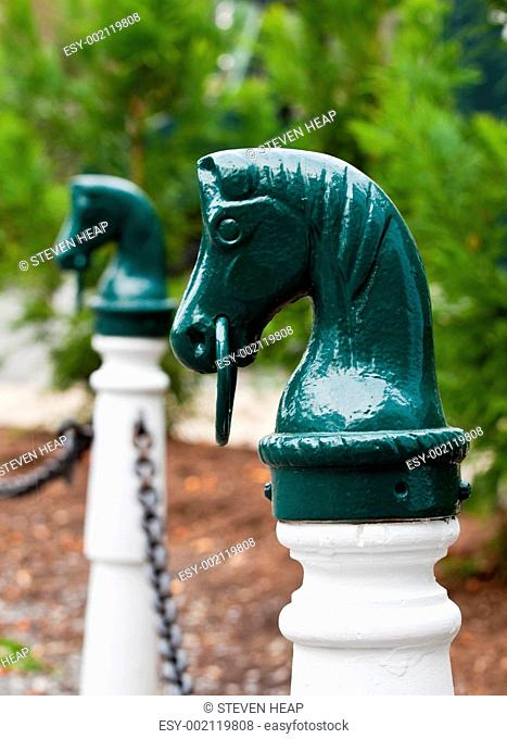 Green horse head hitch post