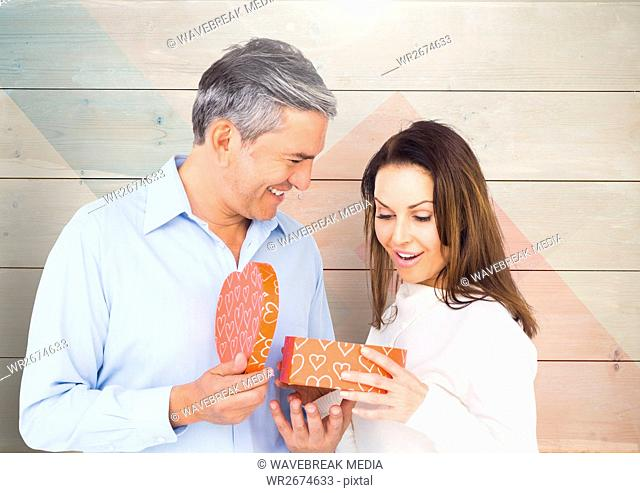 Mature man giving surprise gift to woman