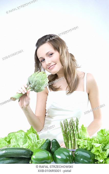 young woman with various vegetables