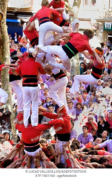 Nens del Vendrell Human tower falling  `Castellers' is a Catalan tradition Fira de Santa Teresa, town festival  Plaça Vella El Vendrell Tarragona province