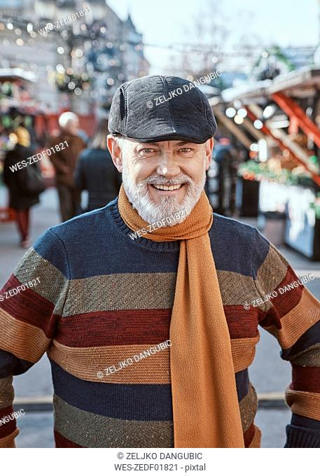 Portrait of a mature man at the Christmas market