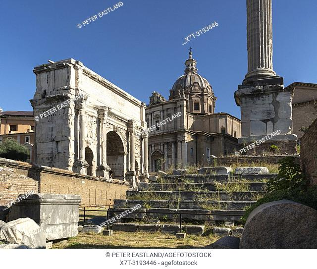 Looking across the Roman Forum towards the Arch of Septimius Severus, With the church of Santi Luca e Martina in the background. Rome, Italy