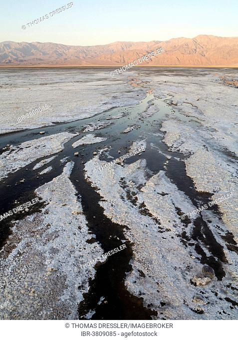 Salt marshes in the morning, Panamint Range in the back, central Death Valley, Death Valley National Park, California, USA