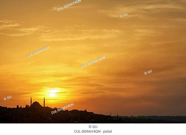 Sultan Ahmed Mosque silhouetted against golden sunset, Istanbul,Turkey