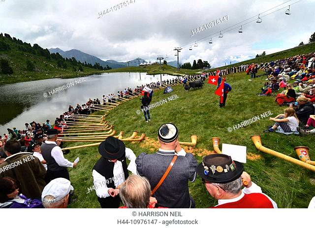 NENDAZ, SWITZERLAND - JULY 27: All contestants together by the lake at the finals of the 13th International Festival of Alpine horns : July 27
