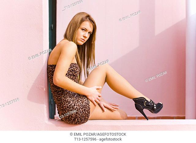 Young lady is sitting on the edge