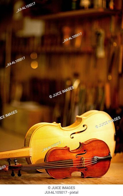 Two violins in workshop