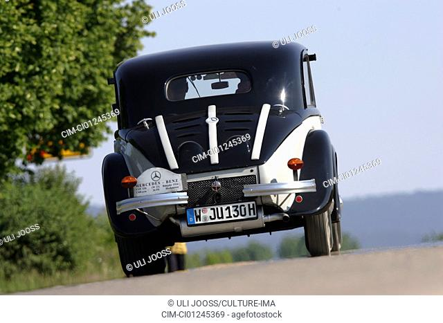 Car, Mercedes 130, Vintage approx., The 30s, Limousine, driving, diagonal from the back, rear view, country road, landscape, Summer, photographer: Uli Jooß