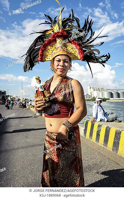 People carrying statues of Santo Niño during the celebration of Dinagyang, Iloilo, Philippines