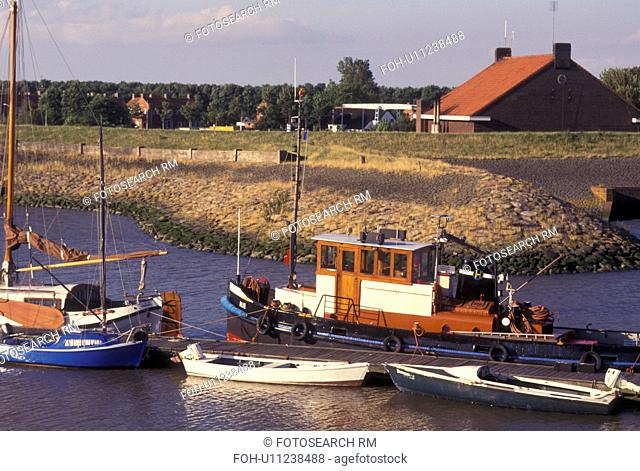 Netherlands, Holland, Groningen, Termunten, Europe, Boats docked in the harbor on the North Sea in Termunten