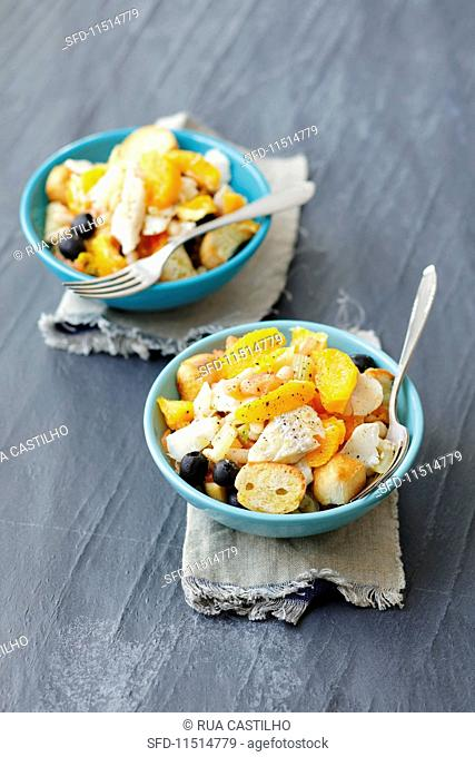 Cod salad with white beans, oranges, olives, tomatoes and croutons