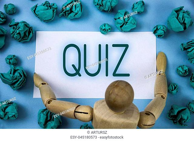 Conceptual hand writing showing Quiz. Business photo text Short Tests Evaluation Examination to quantify your knowledge written Sticky note paper Blue...