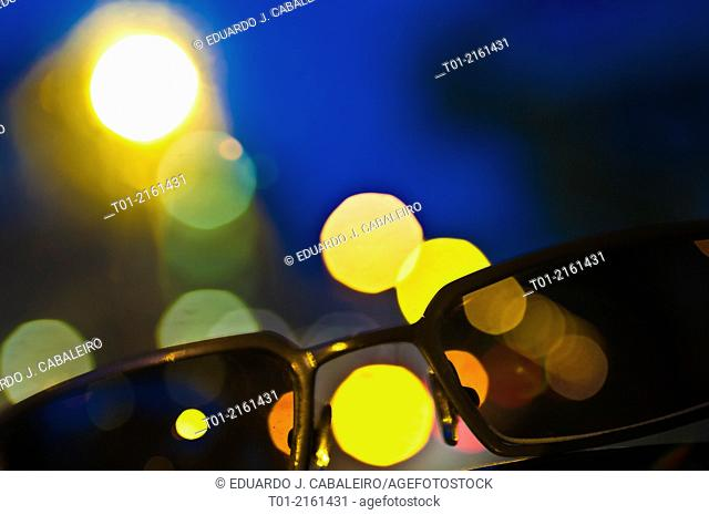 sunglasses with city lights background