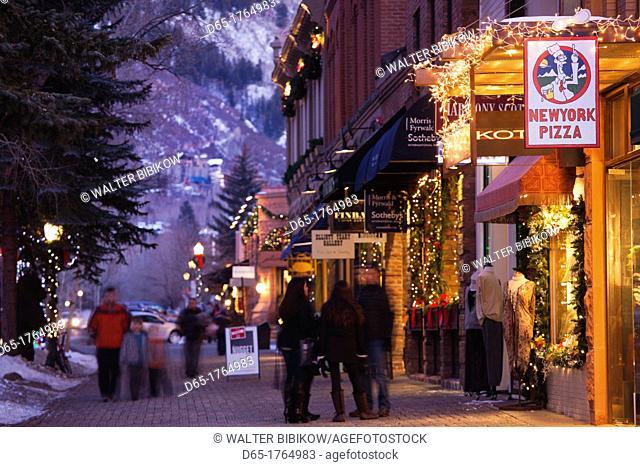 USA, Colorado, Aspen, downtown shoppers, dusk