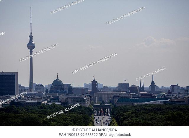 17 June 2019, Berlin: The Berlin television tower, the Brandenburg Gate (front M) and the Red City Hall (back M) can be seen from the Berlin Victory Column