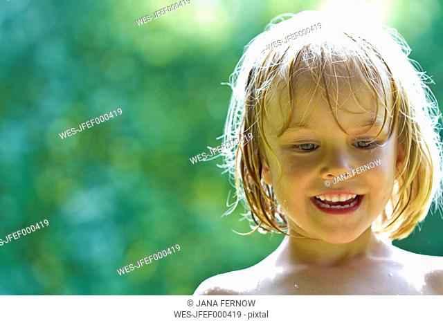 Portrait of smiling little girl with wet hairs