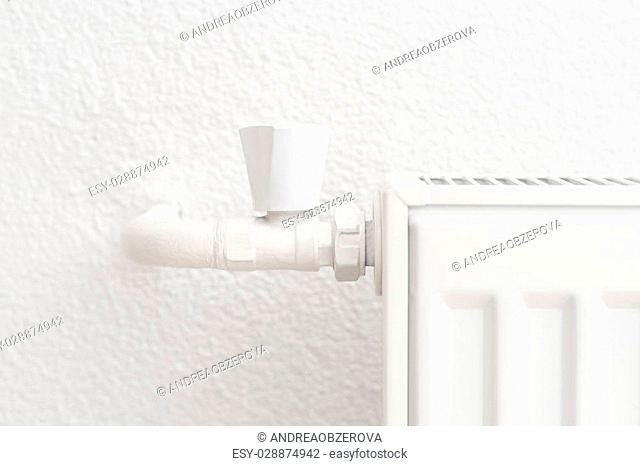 White heating radiator in an apartment. Detail shot with copy space