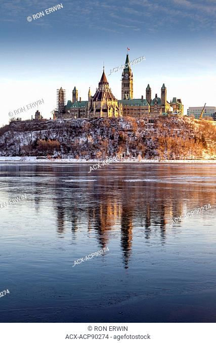 Parliament Hill on the banks of the Ottawa River as seen from Gatineau, Quebec, Canada