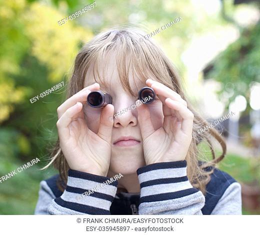 Boy Looking Through Tubes as Binoculars Outdoors