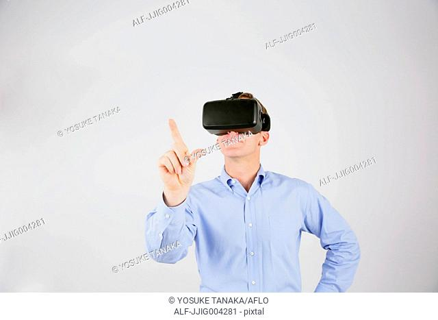Caucasian man using virtual reality device