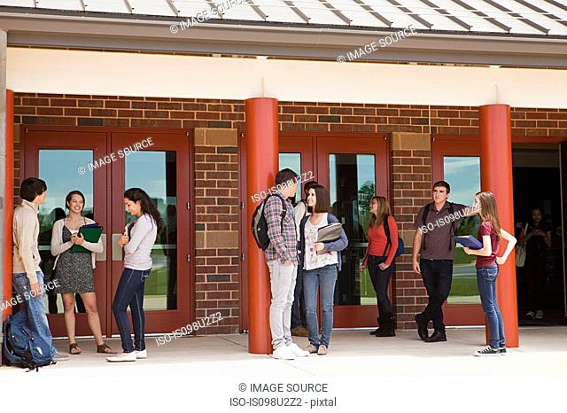 High school students outside school building