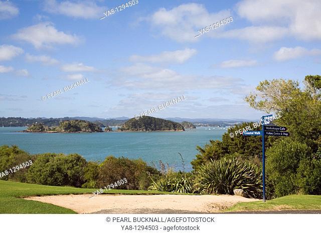 Waitangi Bay of Islands Northland North Island New Zealand  Coastal path with tourist signpost at Waitangi National Reserve in the Treaty House grounds