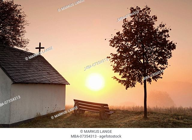 Chapel at sunrise, early morning fog in autumn, Hunsrück, Rhineland-Palatinate, Germany