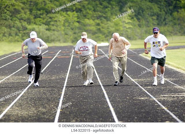 Males run the 100 yard dash at Senior Olympics. St. Clair County, Michigan, USA