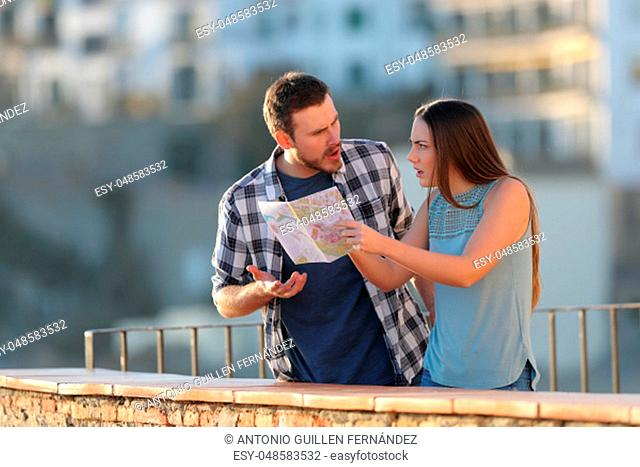 Angry couple arguing about travel destination on vacation in a town