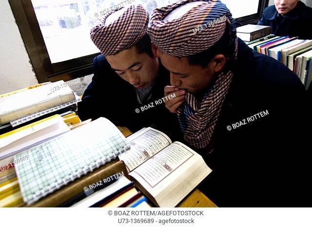 Hui Muslim boys studying the Qur'an in a Medressa in Gansu province