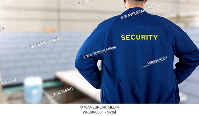 Security man on building site