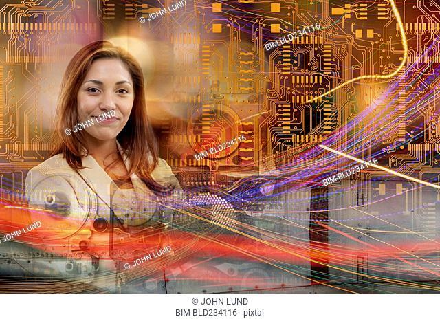 Multiple exposure of Hispanic businesswoman and circuit board