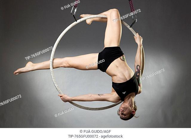 sporty woman on an aerial hoop