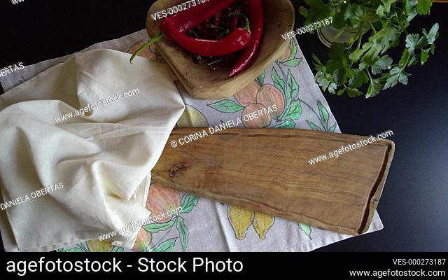 Woman brings to the table a freshly baked pie and puts it on a wooden cutting board